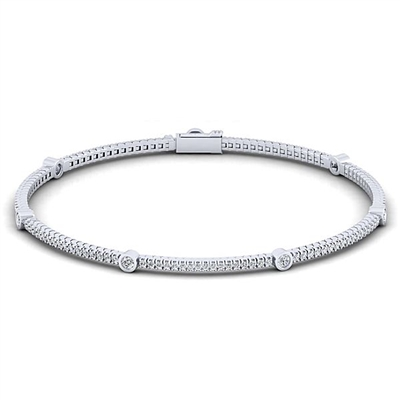 Over one and a quarter carats of round diamonds line up in this 14k white gold diamond tennis bracelet.