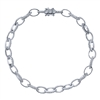 Alternating diamond links connect in this 14k white gold diamond tennis bracelet.