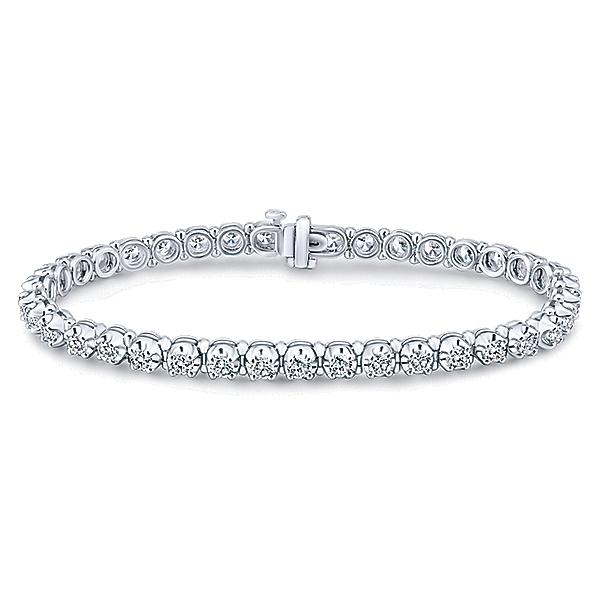 9425121df271c4 This classic diamond tennis bracelet in 14k white gold features 4 carats of  round brilliant diamonds