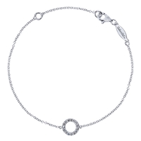 A singular diamond circle sits in the center of this 14k white gold diamond bracelet.