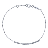 This shimmering diamond bracelet showcases 0.14 carats of round brilliant diamonds lining up in a single,glistening row in this 14k white gold diamond bar bracelet.