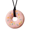 Got Special KIDS|The Munchables Donut Chew Necklace is our firmest design. It features a slightly textured front side that has raised sprinkles on it and a smooth reverse side.