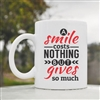 A smile costs nothing but gives Coffee Mug