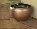 Decorative garden hose pot.
