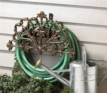 Filigree Hose Holder is used to organize and store garden hoses.