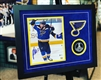 8x10 framed autographed Pat Maroon print and puck, authenticated by Beckett