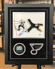 8x10 framed autographed Ryan O'Reilly print and puck, authenticated by Beckett