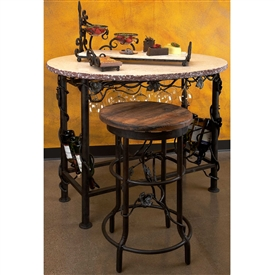 Pictured here is the Wrought Iron Oval Wine Tasting Table featuring a white marble top from Bella Toscana