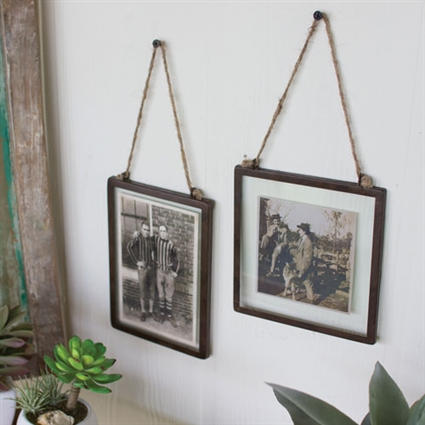 Pictured here is the Set of 2 Glass Photo Frames with Metal Trim at Timeless Wrought Iron.