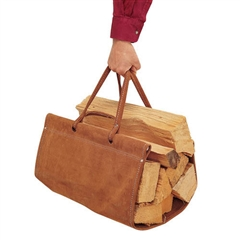 "Pictured here is the brown Suede Fire Wood Carrier from Pilgrim Home and Hearth that measures 29""W x 17""D"