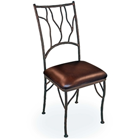 Pictured is the South Fork Iron Dining Chair in Aged Bronze with a Brown Leather seat made by Mathews and Company.