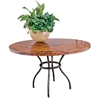 "Pictured here is the Woodland Dining Table with 48"" Round Copper Top hand crafted by skilled artisan blacksmiths."