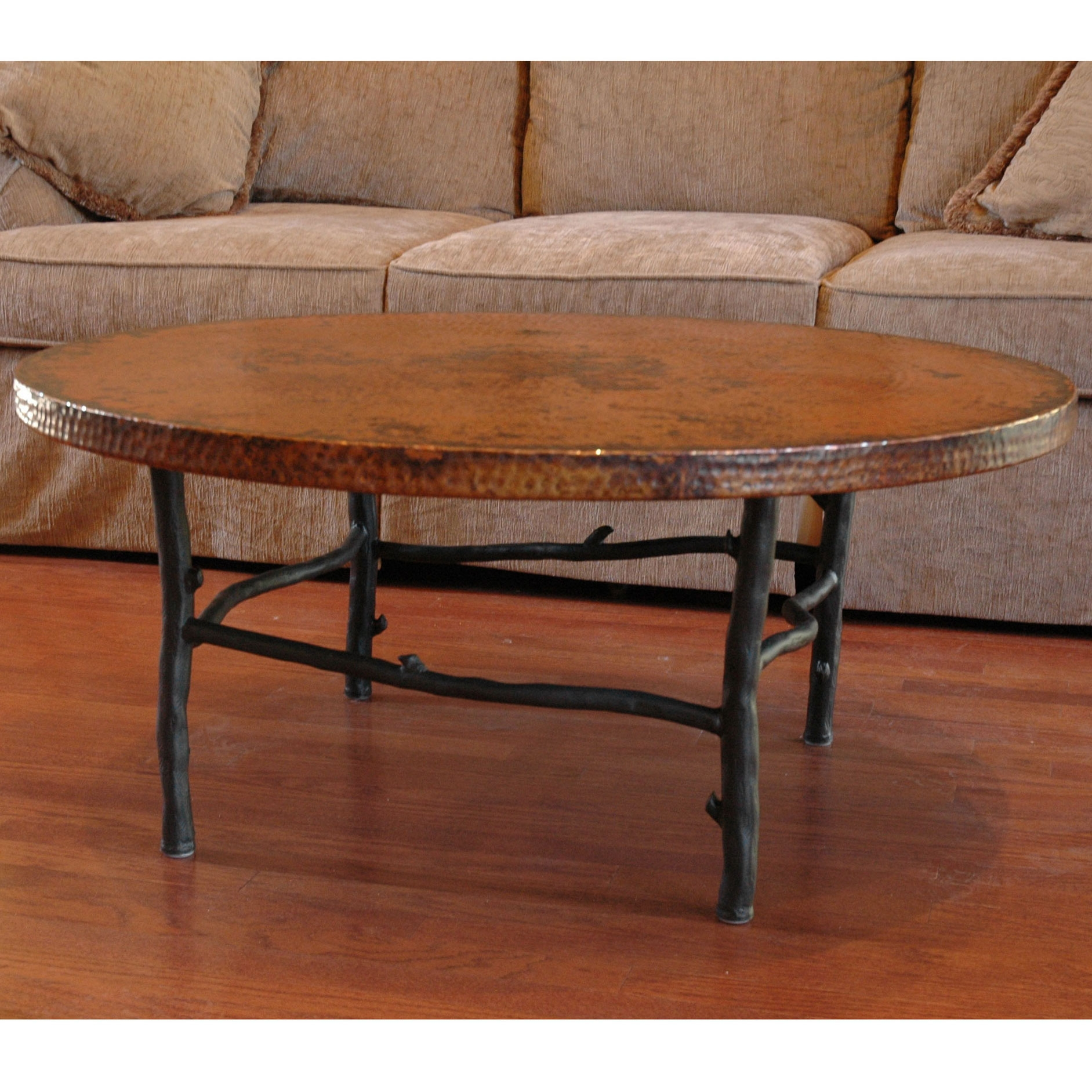 Rustic south fork wrought iron coffee table 42inches round pictured here is the south fork wrought iron coffee table with a 42inch round copper top geotapseo Image collections