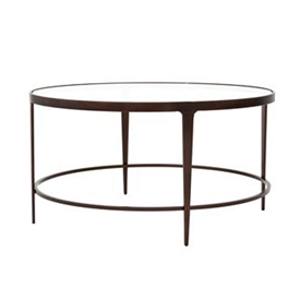 Pictured is the Roundabout Cocktail Table which measures 35-in dia. by 18.5-in high, with custom iron finishes and table top options to choose from.