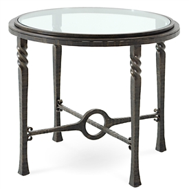 Pictured is the Omega Round End Table with glass table top from Charleston Forge. The solid wrought iron table base is available in several custom iron finish options.