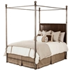 Pictured here is the Luxurious Davant Canopy Bed with oversize iron posts and a plush upholstered headboard, hand-forged by an American furniture company Charleston Forge