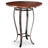 Pictured here is the Camino Bar Height Table with 48-in top, available in custom iron finishes and various wood, glass or stone table tops to choose from.