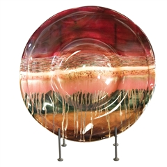 Pictured here is the Sugar Plum Glass Charger with Iron Base from Couleur