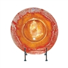 Pictured here is the Orange Glow Glass Charger with Iron Stand from Couleur