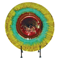 Pictured here is the Mountain Meadow Glass Charger with Iron Stand from Couleur