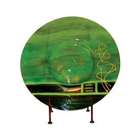 Pictured here is the Iguana Green Glass Charger with Iron Stand from Couleur