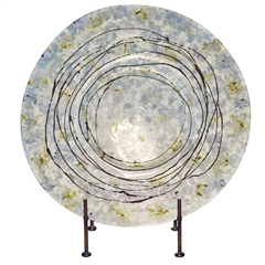 Pictured here is the Moon Dance Glass Charger with Iron Stand from Couleur