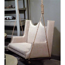 Pictured here is an indoor Iron Swing in our elegant Princess design style. Iron swing is fully upholstered in a soft beige tone. Swing is suspended by natural rope.