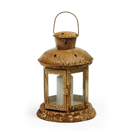 Pictured here is the Dune Candle Lantern with antique rusted finish.