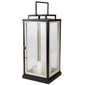 Pictured here is our contemporary styled Concordia Lantern. The design features clean lines, constructed of glass, wood, and aluminum. Lantern measures 11 inches long by 11 inches wide and stands 23.5 inches high.