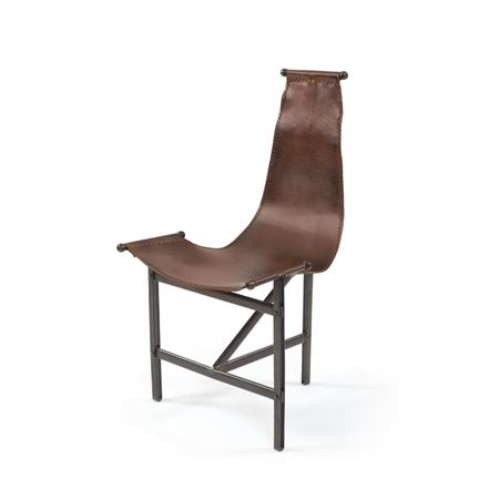 Pictured here is the Eileen Chair with black iron frame and brown leather sling.