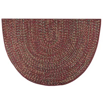 Pictured is the 27 inch x 48 inch Reversible Red Braided Hearth Rug manufactured in America by Goods of the Woods