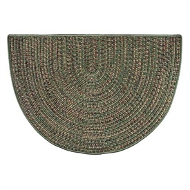 Pictured is the 27 inch x 48 inch Braided Green Multicolor Hearth Rug manufactured in America by Goods of the Woods