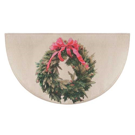 Pictured is the 27 inch x 48 inch Seasonal Holiday Wreath Fireplace Rug manufactured in America by Goods of the Woods.