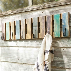 Pictured here is the one of a kind Painted Recycled Coat Rack with Hand Forged Hooks at Timeless Wrought Iron.