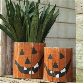 Pictured here is the hand crafted Round Wooden Jack-O-Lantern Planters, sold as a set of two at Timeless Wrought Iron.