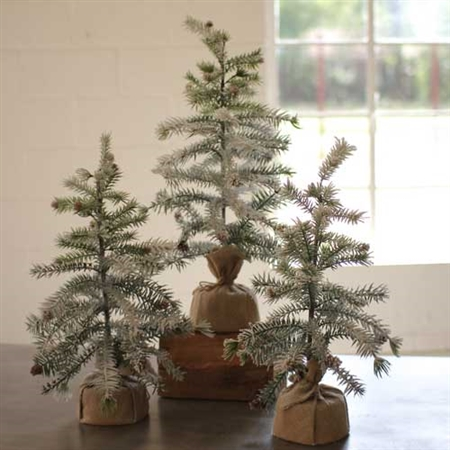 Pictured here is our Set of 3 Pine Trees with Snow Detail and Burlap Pot sold in a set of 3