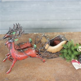 Pictured here is the Recycled Iron Reindeer with Sleigh at Timeless Wrought Iron.