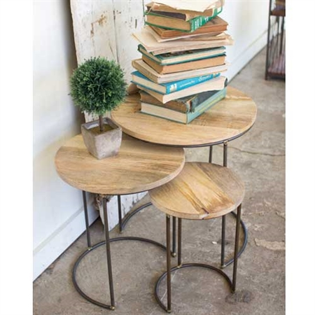 Pictured here is a set of 3 Nesting Tables featuring a mango wood table top and contemporary design.