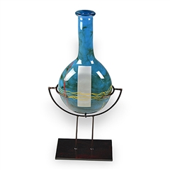 Pictured here is the Mid-Night Blue Tall Glass Bottle with Stand from Couleur