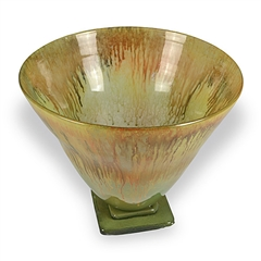 Pictured here is the Honeysuckle Tall Glass Bowl from Couleur