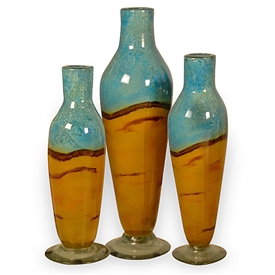 Pictured here is the Tropical Triangle Glass Bottles Set 3 from Couleur