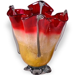 Pictured here is the Rise and Shine 4 Point Glass Vase from Couleur
