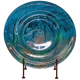 Pictured here is the hand blown Turquoise Charger with Stand manufactured by Mathews and Company.