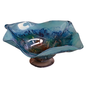 Pictured here is the hand blown Turquoise Glass Bowl manufactured by Mathews and Company.
