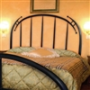 Pictured here is the Pinnacle Wrought Iron Headboard hand forged by artisan blacksmiths.