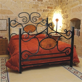 Pictured here is the Alexander II Wrought Iron Bed with Copper hand forged by artisan blacksmiths.