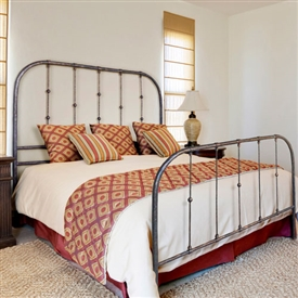 Pictured here is the Monticello Wrought Iron Bed hand forged by artisan blacksmiths.