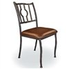 Pictured here is the one of a kind hand forged Corinthian Dining Side Chair that features a contemporary design style with a variety of iron finishes and upholstery options including wood, cloth and leather.