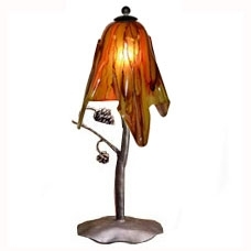 Pictured is our Rustic style wrought iron Piney Woods Table Lamp with Small Glass Shade hand-made by Mathews & Co.