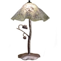 Pictured is our Rustic style wrought iron Piney Woods Table Lamp with Large Glass Shade hand-made by Mathews & Co.